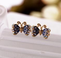Radiant Butterfly Stud Earrings $5.98