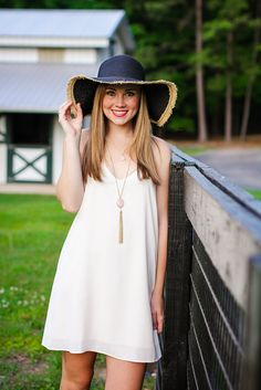 Dresses go hand-in-hand with summer, and this neutral cream dress is perfect for warmer weather! http://ellieclothing.com/product/sweet-serendipity-cream-racerback-dress/