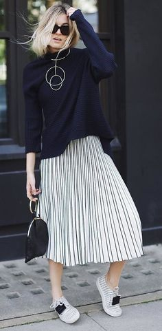 pleated midi skirt + knit + sneakers. black and white. street style.