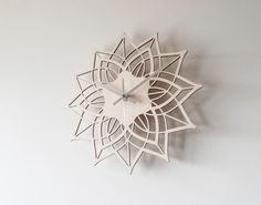 This modern wall clock is called Contemporary Flower . The wooden clock face is laser cut from birch plywood. Outside diameter of face at widest