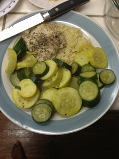 Lemon-thyme chicken with summer squash.  Sautéed and served over Cous, Cous, 300 calorie meal!
