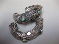 A pair of silver bracelets from Saudi Arabia. Khaneikey .com