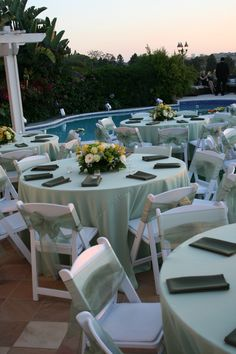 Pastel green satin table cloths  white wood padded folding chairs with  sheer green sashes andNatural wood padded folding chairs and custom pink fabric tent  . Padded Folding Chairs Wood. Home Design Ideas