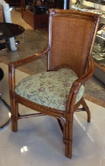 """Set of 4 Palacek """"Palma"""" rattan dining chairs. Top quality and superb design. Bamboo with leather bindings, double wall cane back and upholstered seat. Made by Palacek, Sand Francisco, CA. 25"""" x 21"""" x 39"""" tall."""