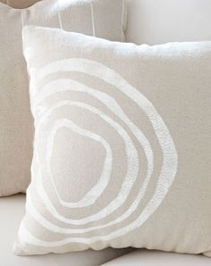 Make a quick-and-easy faux-bois (false wood) pillow cover with a stencil and a drop cloth. All you need are basic sewing skills and about $30.