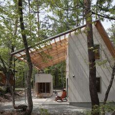 Cedar-clad+villa+by+Naka+Studio+shelters++a+huge+terrace+beneath+its+roof