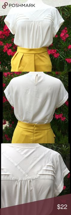 """J.Crew Short Sleeve White Blouse Semi-Sheer Matte Crepe Fabric, Hand Wash Cold, Line Dry, Button & Loupe closure in back, Stitched down Geometric Designs on upper portion of front,  Sewn down Cuffs, Size a Tag & Fabric Content tag are missing, go by measurements!! Bust is 20"""", Length is 24"""", seems like an 8, no Rips, Tears or Stains, barely off white J. Crew Tops Blouses"""