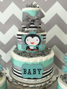 This popular Penguin Winter Wonderland Set of 3 Diaper Cakes is our top selling design! Decorated in Mint, Gray and Black color scheme along with handmade snowflakes in coordinating mint and gray. Designed with brand name diapers and high end materials this baby shower set would make the perfect accent to the themed baby shower! WINTER WONDERLAND DIAPER CAKE INCLUDES: ------------------------------------------------------------------------------------------------ 40-45 Pampers Swaddlers…