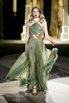 The dragon Rhaegal    Rhaegal has scales of bronze and moss green which, when catching the light, gleam like jade. His eyes are the bronze of polished shields and glow in their own heat. His flame is orange and yellow fire shot through with veins of green.  Roberto Cavalli F/W 2007