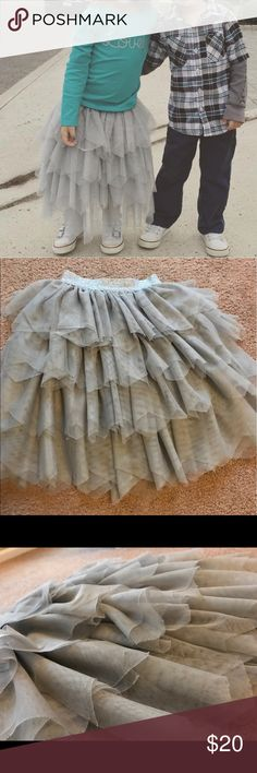 Grey tulle layered skirt - size 2T/3T Beautiful light grey layered tulle skirt. Long - can be dressed up with fancy shoes or dresses down with sneakers for a more casual look (as seen in pic). Size 2T/3T- lined throughout with elastic waste so it'll fit both sizes Bottoms Skirts