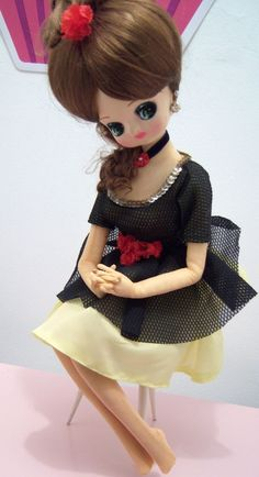 Super cute Bradley doll dressed in black & yellow. She is in great condition, with the exception of her missing shoes.    From a non-smoking home.