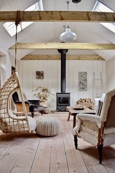 Rattan hanging chair, wood burning stove, antique wooden floor and a deconstructed chair create a bohemian, modern rustic farmhouse look Living Room Designs, Living Spaces, Turbulence Deco, Style Deco, Cottage Interiors, Scandinavian Home, Sweet Home, House Design, Wood Burning