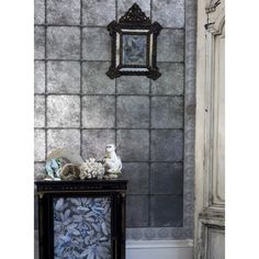 Kings Mirror is a fabulous metallic wallpaper with a reflective tiled effect.  Subtle leaves and flowers are printed over a foil backing to create a beautifully decadent pattern.  It is embellished with decorative jewel-like flower heads at the tile joins. This opulent yet demure wallpaper is inspired by the by King William III's Baroque quarters at Hampton Court Palace.