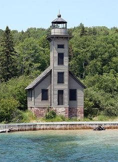This picture of the Grand Island, Michigan, East Channel Lighthouse to the left show the dramatic results produced by restoration efforts carried out sometime between 2001 and 2005. A local group known as the East Channel Lights Rescue Project has not only built the protective wooden crib in front of the lighthouse but has also restored and painted the structure.