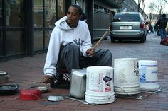 """""""Street Drummers -- Jermaine Carter has played buckets in Boston, Ma ever since I can remember. He has also played in Baltimore, Philly, New York. His sound of tribal rhythms resonate through Downtown Crossing, he is a 26-year-old from Dorchester with a face like Sammy Davis Jr. People that are interested in bucket drumming should take some drum lessons from this guy. He is the man."""""""