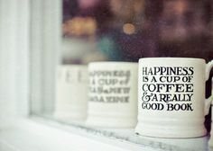 Happiness is a cup of coffee and a really good book