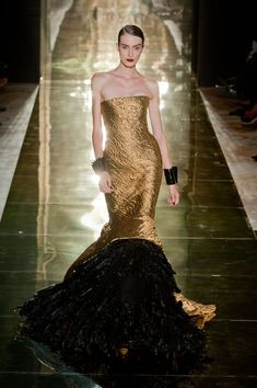 Georges Chakra. I wish it was acceptable/practical to wear gowns like this all day every day...