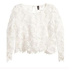 "Ivory Lace Floral Crochet Top Winter White Blouse Winter white lace floral crochet top from H&M (Divided.) Size 8. The color is in between pure white and ivory. New without tag. No flaws.  Measures approx 20"" long from the back collar to bottom hem. Smoke-free home. NO TRADES. Offers welcome!  H&M Tops Blouses"