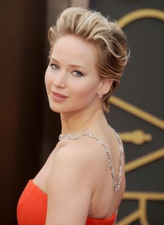 Jennifer Lawrence at the Oscars in 2014 with her cropped hair and Neil Lane 100-carat diamond necklace made for good over-the-shoulder moments.