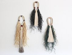 Tassel wall hangings *black raffia/sold out Made with cotton rope, silk, vegan suede cord, raffia, linen and hemp cord. Picture #2, #3 and #4 show the dimensions. If you have any questions, please feel free to mail me. Please take a moment to read through our shops policies BEFORE