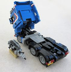 The truck itself has an engine fitted, but due to the steering mechanism interfering, I only built the bits that are visible. However, they are as close to the engine sitting next to the truck as I could make them with the space I had. Lego Tractor, Lego Truck, Cool Lego, Cool Toys, Lego Crane, Lego Gears, Lego Machines, Amazing Lego Creations, Lego Construction