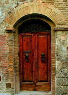 Lovely Italian door with lion doorknockers...No. 17 on some picturesque street
