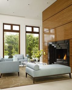 Asian decor with a modern feel - love the beautiful use of wood. Fireplace, a must!