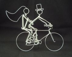 Perfect for Wedding Cake Toppers!  When you purchase mention the names you require in message to seller. Usually written bride❤groom. I will write the names in the order that you write in Message to Seller. Please note that our bicycle cake toppers are only made with SILVER colored aluminum wire. Some clients have spray painted our toppers gold with a few light coats of acrylic enamel paint. These miniature wire sculptures are made by husband Marc-André. He has been making wire bicycles for…