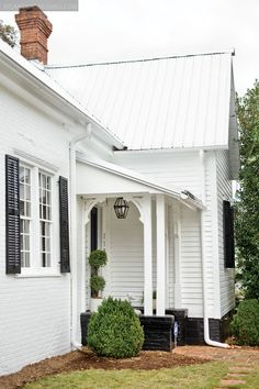 We are seriously considering a metal roof in either a metal, red or green finish… – white farmhouse White Farmhouse Exterior, Farmhouse Style, Modern Exterior, Life Design, House Design, Roof Design, Provence, Black Shutters, White Siding