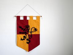 House gryffindor banner - harry potter Hogwarts houses sorting hat - Griffin embroidery red yellow gift home decor wall decor hanging fabric by Oki007 on Etsy https://www.etsy.com/listing/506017576/house-gryffindor-banner-harry-potter