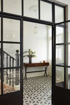 Killer Entryway Inspiration Check out these amazing entryway tile floor ideas for your foyers Tiled Hallway, Tile Entryway, Hall Tiles, Entry Tile, Entryway Flooring, Entry Doors, Entryway Decor, White Hallway, Entryway Stairs