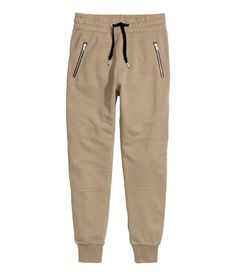 Jogger-style pants in sweatshirt fabric. Elasticized drawstring waistband, side pockets with zip, and back pockets. | H&M Divided Guys