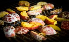 Fresh sliced peaches covered in a coconut sauce on the grill.