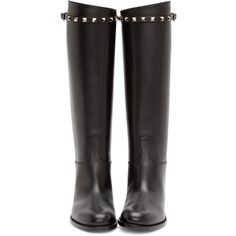 Tall buffed leather riding boots in black.  Almond toe.  Accent strap at collar with signature pyramid studs and pin-buckle in silver-tone.  Stacked leather he…