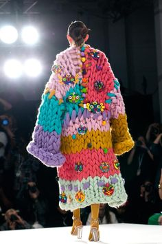 """Hope Macaulay is a luxury and bespoke fashion brand by an emerging Northern Irish fashion and textiles designer. Hope's garments include expressive paintings as prints, detailed beadings and colourful colossal knits handmade in Ireland from 100% merino wool, """"The Best Street Style at London Fashion Week"""" by Vogue"""