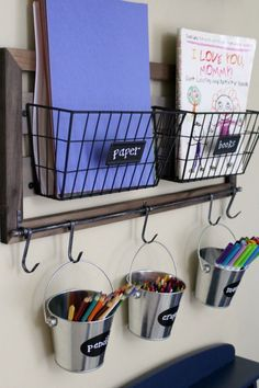 Organized art station for kid's art and craft supplies: Use hanging metal buckets for easy pencil, crayon and marker storage Storage For Art Supplies, Art Supplies For Kids, Kids Art Storage, Arts And Crafts Storage, Craft Supplies, Kids Playroom Storage, Kids Homework Organization, Crayon Organization, Crayon Storage