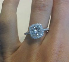 Love; Cushion Cut with Halo setting. Center stone is 2.2 carats, with halo it equals 2.79