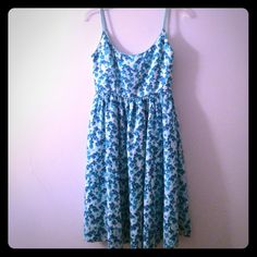Kate spade floral strap dress Kate spade floral strap dress with small bow in the back. Dress has never been worn and is in great condition. Zipper works perfectly. Very flattering dress that would look great for work with a navy blazer! First and second picture is of the front and third picture is of the back kate spade Dresses