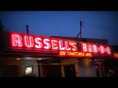The Neon Lights of Russell's Bar B Q. Great Eats In Elmwood Park. Just north of North Ave. on tree shaded Thatcher on the western edge of Elmwood Park Il. is a great old style family restaurant Russell's BBQ. They offer a full range of barbeque; beef & pork, sandwiches or plates of ribs. They also offer other items and have a pretty good kids menu. It's a lovely woody spot with great food and atmosphere including outdoor seating in the back and these great neon signs.