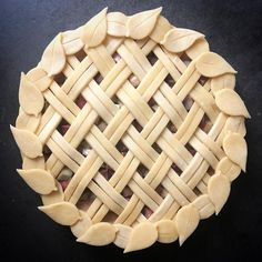 Rhubarb fruit pie with bias two strip pattern weave with simple flying leaf cutout edging