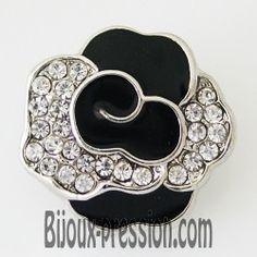 Bouton pression métal fleur noir et strass blanc
