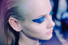 """Urban, street, city—it's quite shocking,"" said makeup artist Pat McGrath of the electric blue ""glitter-on-latex"" eye she was crafting backstage at Dior. Photographed by Kevin Tachman"