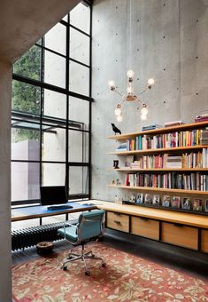 rho architects, home office, high ceilings, steel windows, tall room, wall mounted bookshelf, concrete, black windows, industrial