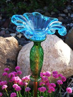 These glass garden ornaments are so simple & fun to make!  If you look closely, they consist of a vase {upside-down}, then other various glass dishes strategically stacked on top, such as; little ice-cream glasses, candle sticks, small plates, & saucers.