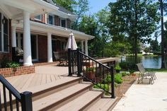 Beautiful wooden deck by Archadeck of Central SC. Features integrated bench seating allowing for unobscured views of scenic Lake Murray, in Lexington, SC. Wpc Decking, Composite Decking, Outside Flooring, Outdoor Spaces, Outdoor Decor, Thermal Insulation, Wooden Decks, Lake View, Natural Wood