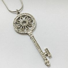 Crystallized Key Necklace simply stunning you'll love the vintage style of the key. 28 inches long with 3.5 inch extension for a total of 31.5 inches in length. The key is approx. 3 inches long. The crystals are simply stunning and you get a lot of sparkle the quality is good you'll love the style great to wear with any outfit or to give as a gift it's stunning!!! Jewelry Necklaces