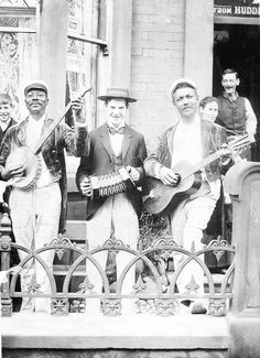 American musicians playing the banjo, concertina, and guitar, from the collection of Stefan Grossman, no further info.