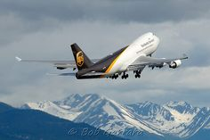 A Boeing freighter of United Parcel Service climbing after departing ANC. Ups Shipping, United Parcel Service, Cargo Airlines, Boeing 747, Airplane, Planes, Aircraft, Photographs, The Unit