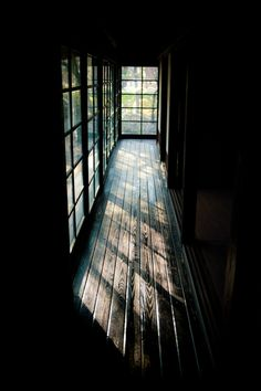 dark and light - black and white - darkness and sunlight - hallway, windows - rustic home