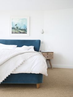 Blue velvet bed and pretty white linens in the Scandi inspired beach house we stayed at in Cornwall recently.